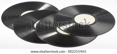 Four black records isolated on the white background - stock photo