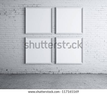 four blank frame on a concrete wall - stock photo