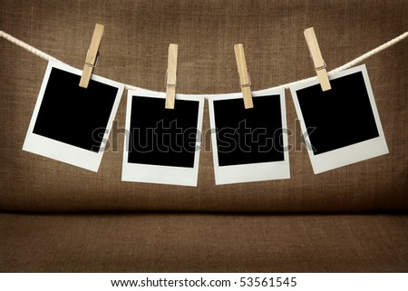 Four blank instant photos hanging on the clothesline