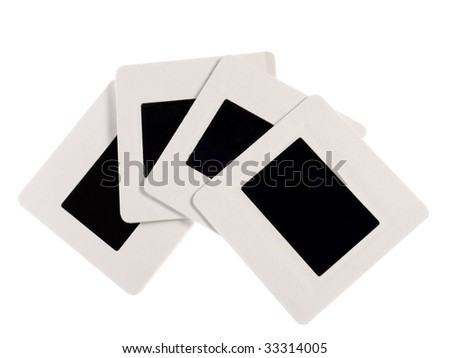 Four blank 35 mm slides with white borders shot on white - stock photo