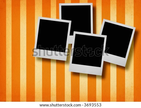 four blank photo frames against retro paper background