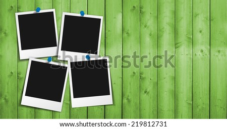 Four blank photo frames with push pin, shadow and empty space for your photograph, picture and copy on green wooden grunge background. - stock photo