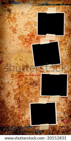 Four blank photos on a grungy wooden background - stock photo