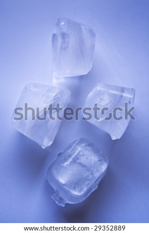 Four blue ice cubes - stock photo