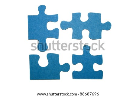 Four blue pieces of a puzzle with a white background - stock photo