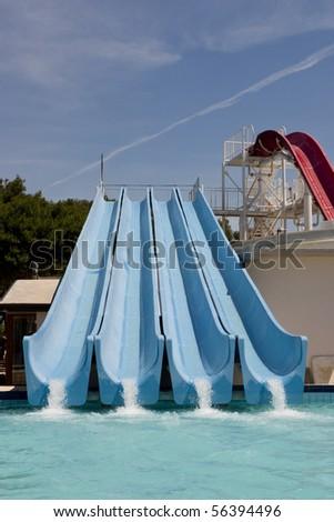 Four blue water toboggans - stock photo