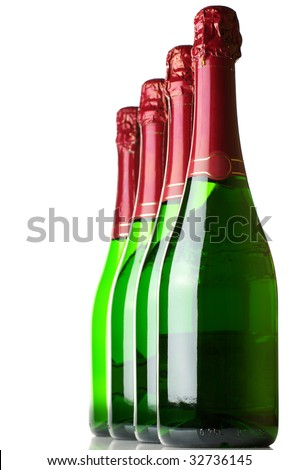 Four bottles of champagne in row on white background. - stock photo