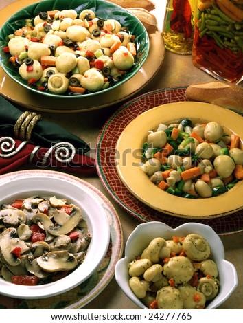 Four bowls of marinated mushrooms. - stock photo