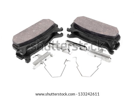 four brake pads and spring, isolatet on white - stock photo