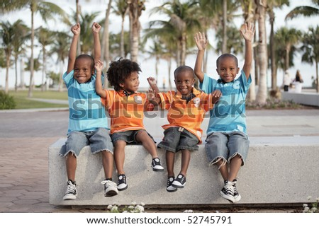 Four brothers in the park - stock photo