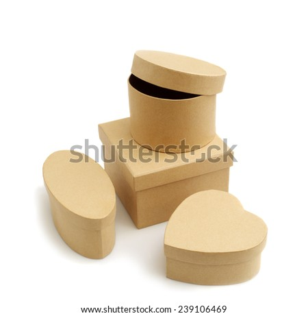 Four brown cardboard boxes isolated on white.Studio shot. - stock photo