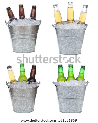 Four buckets holding three each of different beer bottles in ice. The bottles are covered with condensation and isolated on white. - stock photo