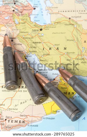 Four bullets on the geographical map of Iran. Conceptual image for war, conflict, violence. - stock photo