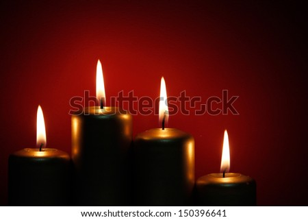 Four burning gold candles