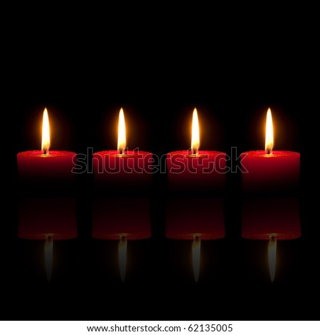 Four burning red candles in front of black background - stock photo