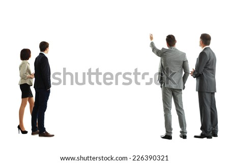 four business mans from the back - looking at something over a white background  - stock photo