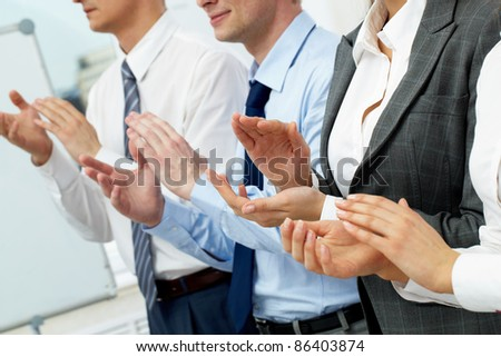 Four business people applauding at seminar - stock photo