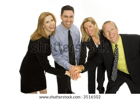 Four business people gesture teamwork together