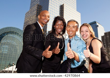 Four business people giving thumbs up. Horizontally framed shot. - stock photo