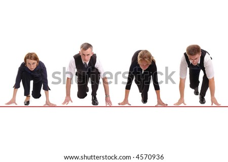 Four business people lined up getting ready for corporate race - rat race concept - stock photo
