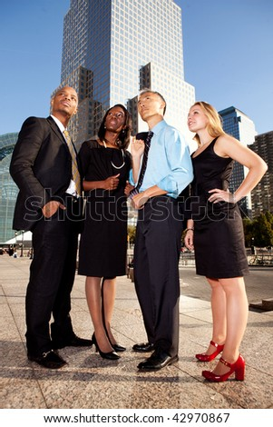 Four business people looking up. Horizontally framed shot. - stock photo