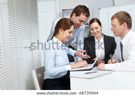 Four business people making their everyday work - stock photo