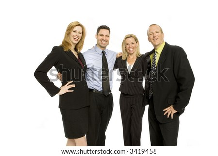 Four business people stand together and smile