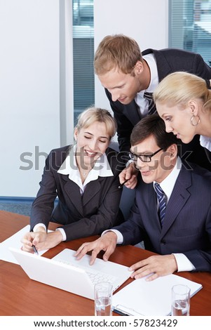 Four business people to discuss any issue in the office - stock photo