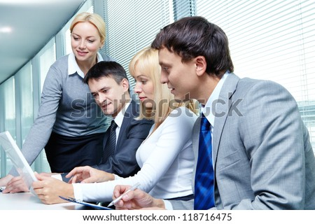 Four business people working at meeting - stock photo