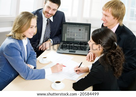 Four business people working in team - stock photo