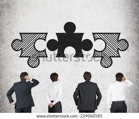Four Businessmen and three pieces of puzzle. Problem solving concept.  - stock photo
