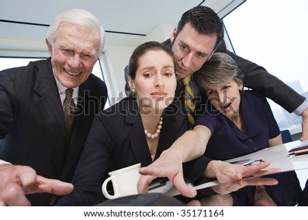 Four businesspeople - stock photo