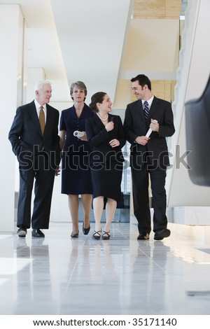 Four businesspeople in conversation.