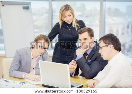 four businesspeople interacting at meeting - stock photo