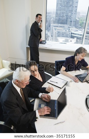 Four businesspeople meeting - stock photo