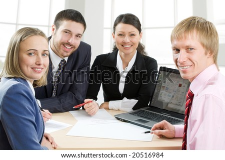 Four businesspeople smiling - stock photo