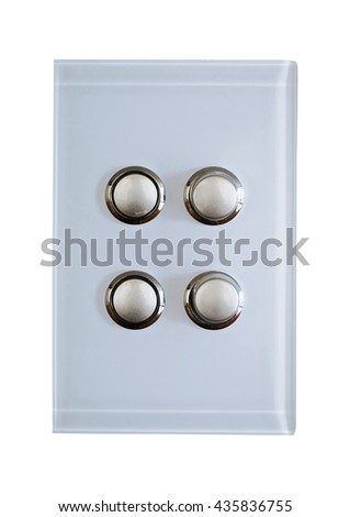 four buttons  on a modern light switch - stock photo