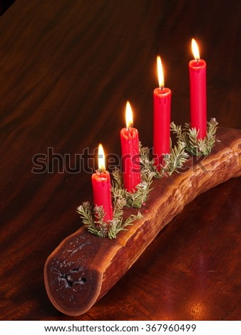 Four candles in a timber plank with Christmas decoration, Melbourne 2015  - stock photo