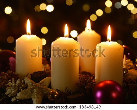 Four candles with christmas decoration - stock photo