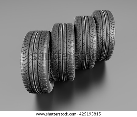 Four car tires on grey background. 3d illustration - stock photo