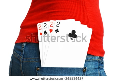 Four cards of two in rear pocket of a lady in Jeans - stock photo