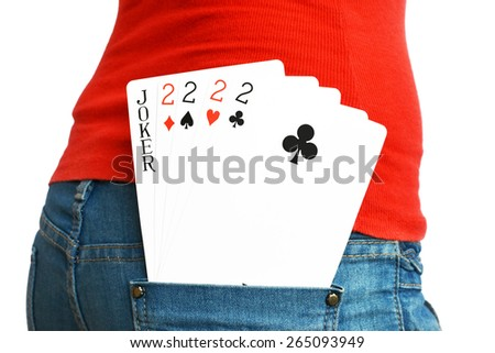 Four cards with a Joker in a rear pocket of a lady in Jeans - stock photo