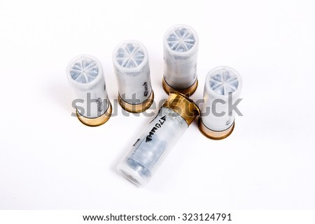 Four cartridges for hunting rifle isolated on white background. - stock photo