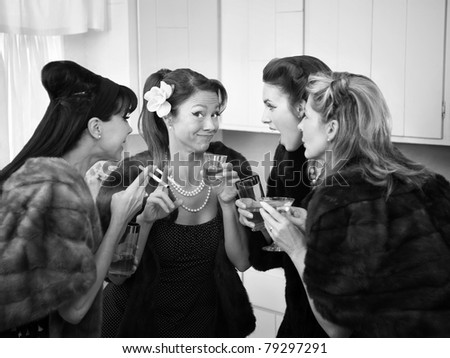 Four Caucasian women in mink coats smoking and drinking - stock photo