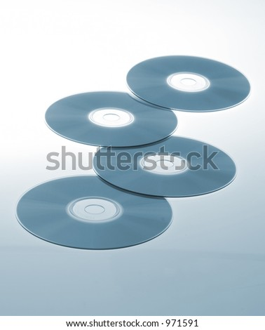 Four CD or DVD abstract - stock photo