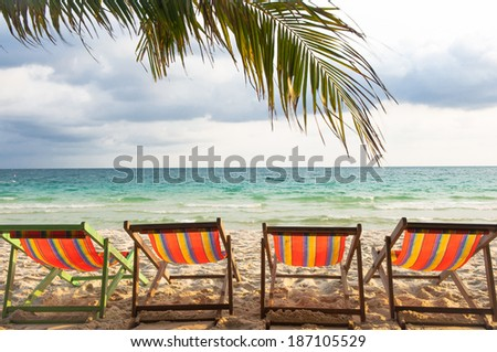 Four Chair at the beach - stock photo