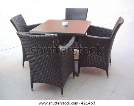 four chairs and table - stock photo