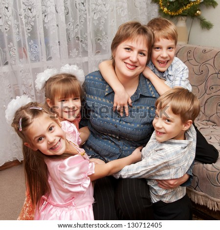 Four children hugging mother. Family and love concept. - stock photo