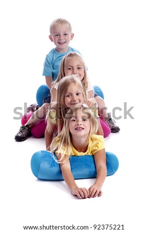 four children in a row. isolated on white background - stock photo