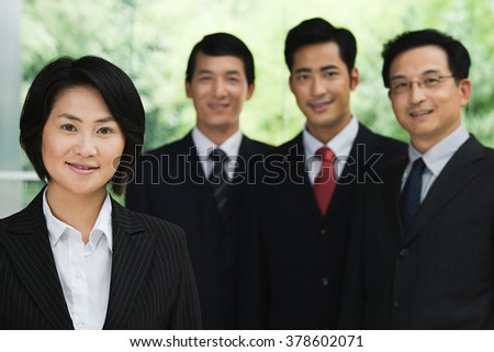 Four Chinese businesspeople - stock photo